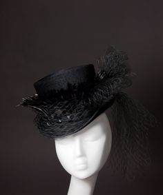 House of Nine Designs - Black Velvet 'Sabrina' Top Hat  This ladies hat is made from high quality velvet-finish fur felt in glossy black. Shiny, wispy black hackle feathers ring the crown of the hat, along with a jet-beaded felt band and a generous amount of antique silk veiling looped into a large bow and held in place with a jet button toward the back.