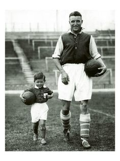 Eddie Hapgood Football Player of Arsenal, Aug 1934 with his son, the mascot of the team. A footballing image from the 55MAX archive.