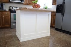 Add Molding to a Builder Grade Kitchen Island: An Easy How-To - Love Remodeled Kitchen Island Molding, Kitchen Island Makeover, Kitchen Cabinets, Island Kitchen, Kitchen Island Remodel Ideas, Small Kitchen Islands, Kitchen Island Upgrade, Kitchen Cabinet Molding, Cupboards