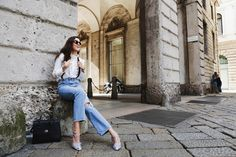 Jeans with suspenders and white blouse