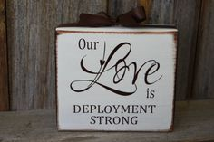 Our Love is deployment strong - military wood block and vinyl lettering with ribbon by invinyl
