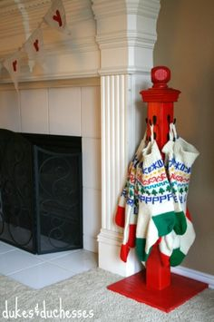 Start with this idea but leave wood natural or distress it and use old hooks and/or door knobs to hang stockings.