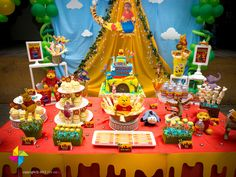 Backdrop & cake / candy table for a Winnie The Pooh themed 1st birthday party. Design & setup by ParteeBoo - The Party Designers