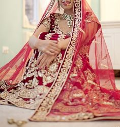 I like the angle, I like that the bride isn't captured from just above or from dead straight on, and that the chunni is spread towards the front....adds a nice effect