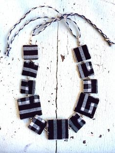 use beads and sewn squares of fabric to make necklace Kasuri Indigo Textile Necklace by lesliejanson on Etsy Textile Jewelry, Paper Jewelry, Fabric Jewelry, Fabric Necklace, Diy Necklace, Arrow Necklace, Jewelry Sets, Jewelry Necklaces, Jewelry Making