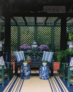 Carolyne Roehm Carolyne Roehm's New York pergola filled with my favorites - Chinese Chippendale, stripes, Chinese garden stools, ginger jars, and lots of blue and white.