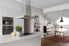 Minimalist white attic apartment in Norrmalm