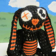 He's such a happy lil' goth bunny! Free crochet pattern. Let's see...goth, emo, scene, punk, zombie, vampire, ghoul, Halloween, and....is that it?