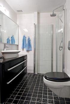 black & white bathroom - using black to ground all the white