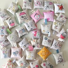 """Day 29 of the #pinnieparade is a repeat. These little (2.5""""-3"""") #sewingillustration pincushions were made back in January. Minki Kim @zeriano designed most of these cute illustrations but a few are my own. This is really a fun technique and gives such cute results! #tinyfloralsanonymous #handmade #pincushion"""
