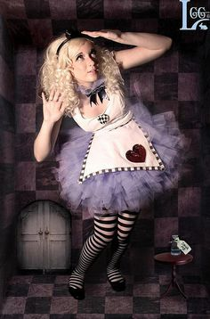 Abby's TuTu Factory custom made the Alice in Wonderland costume exclusively for Looking Glass Girls photography  Shop my exclusive halloween line at www.abbystutufactory.com and at ETSY.com under abbystutufactory.etsy.com It is Spookalicious!    Copyright © 2008 by Abby's TuTu Factory. All rights reserved.