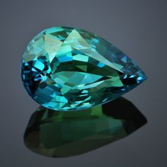 The beautiful color of a tropical ocean of this Kornerupine are probably related to the presence of chromium or vanadium. Because of the size, the color, and the clarity, this is the nicest Kornerupine we ever came across. This stone is step cut pear shape measures 9.70mm x 6.40mm x 4.82mm and weighs 2.01 carats.