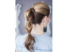 @Byrdie Beauty - Upgrade your average ponytail by braiding halfway down, adding an elastic, then braiding to the ends. Use a texturizing spray beforehands to pump up the volume.