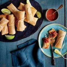 Chicken Tamales with Ranchero Sauce | Forming the tamales, albeit time-consuming, is part of the fun. Make it a family activity and set up an assembly line--one person placing the filling, another folding, and a third tying. This recipe uses lard, which actually has less saturated fat than butter.