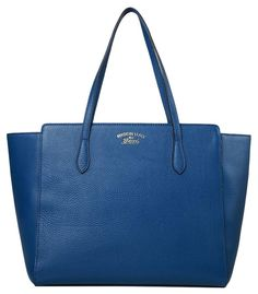 Gucci Swing Blue Tote Bag. Get one of the hottest styles of the season! The…