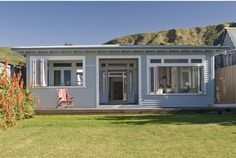 Classic beach house by our beautiful NZ coast, Wainui Beach. Loving the color scheme and the floors. Link to the website . House Paint Exterior, Exterior Paint Colors, Exterior House Colors, Paint Colours, Beach House Colors, Weatherboard House, Modern Backyard, Beach Shack, Beach Cottages