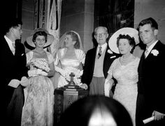 Miss Patricia Kennedy, third from left, stands with members of her family before her marriage to actor Peter Lawford in New York's Roman Catholic Church of St. Thomas More, on April 24, 1954. Left to right are: Sen. John F. Kennedy, a brother, Jean Kennedy, a sister and maid of honor; Patricia; Joseph P. Kennedy, former United States Ambassador to Great Britain and Patricia's father; Mrs. Rose Kennedy; mother of the bride and Robert F. Kennedy a brother.
