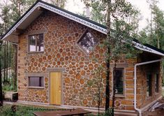 "This is Bruce Lord's lovely double wall cordwood home in Peace River, Alberta, Canada. This has an 8"" outer wall of cordwood, 12 inches of insulation in the center cavity and a 6"" cordwood wall on the inside (total R-50). Finishing the outside first, allows the builder to work on the inside during the winter. The double wall method is the invention of Stackwall builder Cliff Shockey and is detailed in his book Stackwall Double Wall Technique"