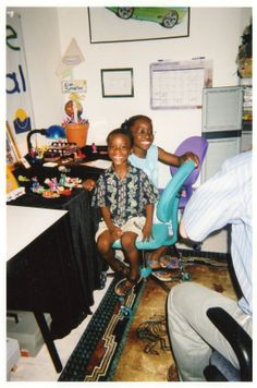 Back in the Day: Darrien and Ebony Bailey smile for KAST (Kids Are Special Too!) news photos and interview in art studio. Camaro-Corvette Artist Concept original in background. They are creating art, writing, sculpture and youth gift baskets. That creativity led to enhancing their creative ability and their contribution to Innervoice Consulting and their own Inner Voice.