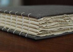A lovely handmade Coptic bound journal boasting handmade paper.