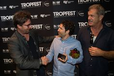 """Director Spencer Susser, winner of Tropfest with his film """"Shiny"""", poses for photos with John Polson and Mel Gibson during Tropfest 2016 at Centennial Park on February 14, 2016 in Sydney, Australia."""