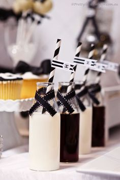 Chanel inspired dessert table- mini milk bottles by www.prettylittlevintage.com.au