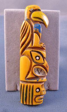 """here's a very rare carved and painted Bakelite Totem Pole brooch pin - measures 3-3/4"""" by 1"""" - this is an original so study closely because there are many fakes out there of this design but most I've seen are pretty obvious especially if you've seen the genuine original here."""