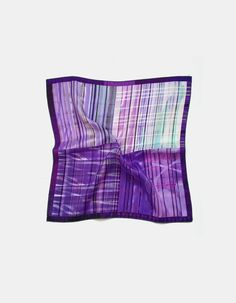 Silk pocket square for him, groom hankie. Elegant handkerchief ideal for an amethyst or lavender wedding. This stylish pocket scarf is made of habotai silk, a soft lightweight material with a non too shiny finish and the pattern is a four tone design combining lavender and purple shades. The hem of the hankie is machine rolled with rayon threadLavender silk pocket square - product image