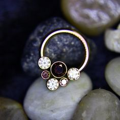 ianmbell:  Is your daith or septum in need of a jewelry upgrade? If so, this Champagne and Brown CZ cluster from @anatometalinc is up for grabs! #legitbodyjewelry @legitbodyjewelry @legitpiercings #bodyart