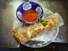 Crispy Vietnamese pancake rolled in rice paper. #vietnamesepancake  #market #hoian  #vietnam #food #dinner #vietnamesefood #restaurant #yummy #delicious #eat #streetfood #foodadventures #tastetravel #tastetravelfoodadventuretours #sunshinecoast #australia #holiday #vacation #instafood #instagood #followme #localsknow #cookingclass #foodie #foodietour #foodietravel