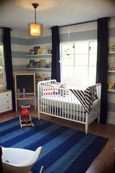 Before & After: Stylish Stripes in a Boy's Bold Nursery beautiful nursery. Love the hanging lamp! Nursery Rugs, Nursery Furniture, Nursery Decor, Striped Nursery, Nursery Stripes, Wall Stripes, Striped Walls, Painted Stripes, Grey Stripes