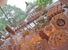 Te ofrecemos mas de 200 opciones diferentes de dulces y chocolates importados, cupcakes, pasteles, postres, dulces típicos Guatemaltecos, galletas y snacks salados para que tu barra sea algo único!   #Guatemala #wedding dessert table boda primera comunion white birdcage white silver mirrors Antigua Guatemala destination wedding first communion baptism christening bautismo mesa de postres barra de dulces chandellier