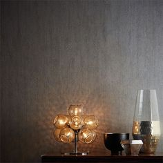 Igneous rock is a form of hardened molten lava and inspired this wallpaper design. It has a 'crackle-glaze' effect, enhanced by minuscule beads fixed with a sparkle adhesive, giving the wallpaper an extra touch of sophistication. Available from www.silkinteirors.com.au #wallpaper #wallpaperforwalls