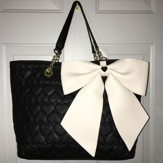 Betsey Johnson purse Black tote with white bow. Gold and black leather straps. Betsey Johnson Bags Totes