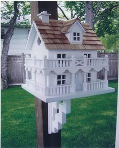 Novelty Cottage Bird House. h1Novelty Cottage Bird House_h1STRONGNovelty Cottage Bird House._STRONGandnbsp Part of our Novelty Cottage Group, this authentic looking bird house features two stories with surrounding decorative gate.andnbsp A door, w.. . See More Birdhouses at http://www.ourgreatshop.com/Birdhouses-C750.aspx