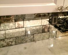 Antique Mirror Backsplash installed in different tile sizes