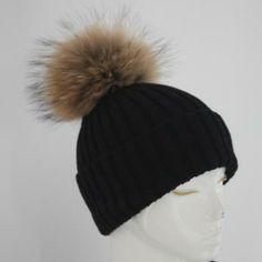 Bobble Racoon Fur Hat . £25 . Black