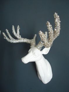White Lacquered, Wooden Deer Head. Antlers adorned with Swarovski Clear Crystals of assorted sizes. Deer Head measures 12X12X6.