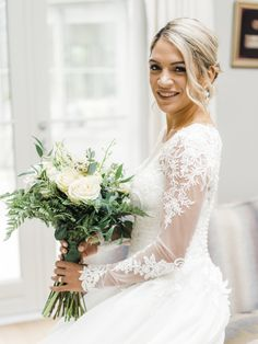 Full sleeve wedding dress with white bouquet. Simone ready for the church in Greystones Co Wicklow Ireland