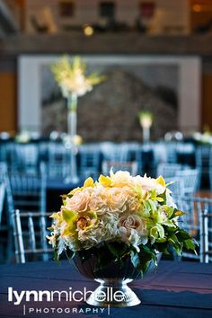 modern white wedding, stunning white and green flower centerpiece, reception area, Modern Art Museum.