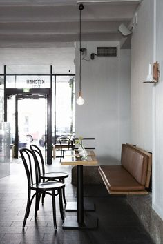 Love the leather seat and french-style cafe chairs here at Bar & Co, Helsinki by Joanne Laajisto