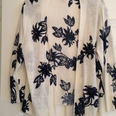Cream topper with Navy Blue floral details Beautiful cream light cardigan with navy blue floral print with embroidery and beading. Gorgeous! In excellent condition. Coldwater Creek Tops