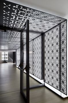 KAUST Offices | Studios Architecture | Photo: Bilyana Dimitrova | Archinect Black and white. Laser cut screen. Backlit decorative pattern. Wall and ceiling entrance. Minimal.