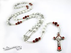 This very special Pope Francis rosary is a lovely Catholic gift and keepsake! MATERIAL: The handmade unique Pope Francis rosary is inspired from the traditional Catholic Five decade Rosary Design. 8mm Hail Mary white Howlite beads are paired with red porcelain Our Father beads.