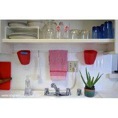 Small Kitchen Ideas: Tension Rod Above the Sinks and Open Shelving - The kitchen in my rental apartment was all white and not all that interesting when I moved…