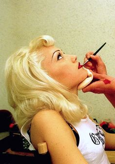 Gwen getting her makeup done