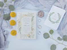 Wedding invitation photography, vow book photography, sage green and yellow wedding colors, rustic floral theme, wedding detail flat-lay -- See more from Carlee & Alexi's wedding on WeddingWire!