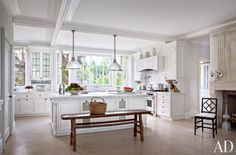 The kitchen in a Hamptons estate is painted in a Benjamin Moore white and features custom-made holophane lights.