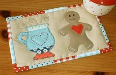 The Gingerbread Cup pattern is adapted to make a Valentine Gingerbread mug rug - so many different looks all from one $1.99 pattern.