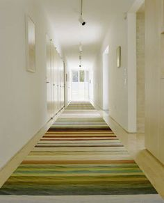 Design Inspiration for the Long Hall Attic Mag via 5 Ways to Decorate a Long Hallway. Railroad effect striped rug. Long Hallway, Upstairs Hallway, Modern Hallway, White Hallway, Striped Hallway, Modern Bedroom, White Walls, Striped Carpets, Striped Rug